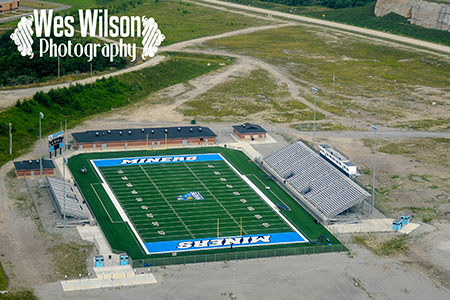 "An aerial view of the James H. ""Buck"" Harless Stadium showing off the full entirety of the facility."