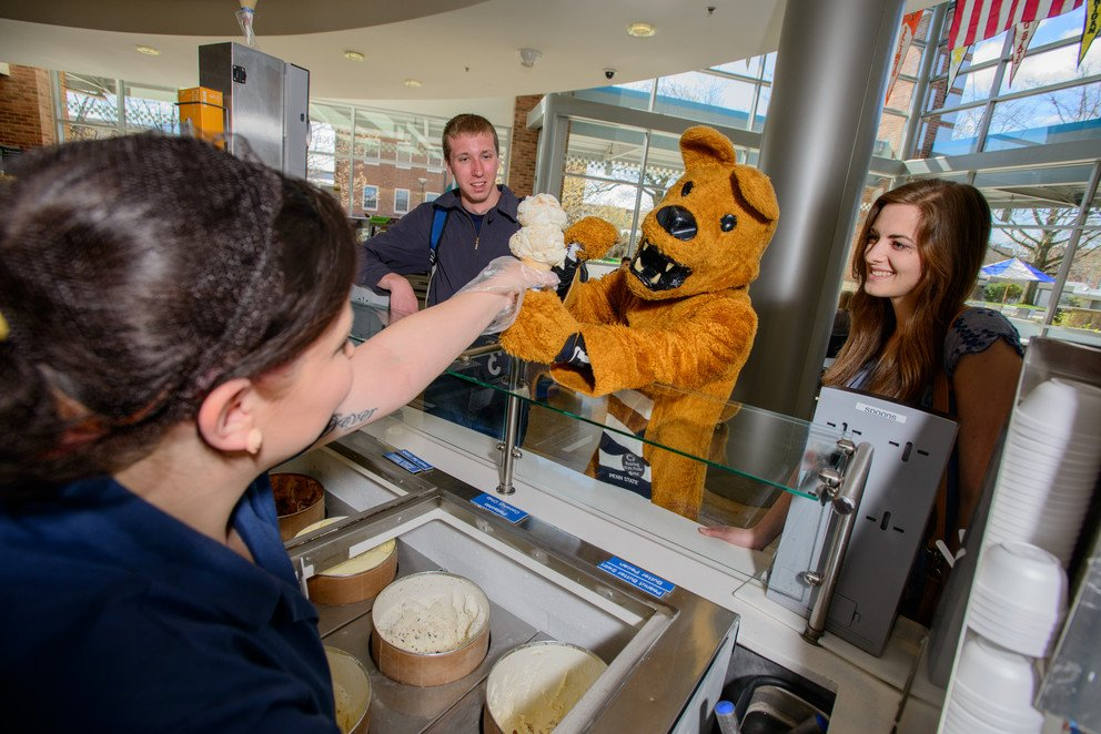 Everyone gets ice cream at the creamery throughout the year, even the Nittany Lion. This photo was taken by Michelle Bixby with the Penn State news.