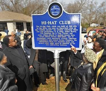 The front of the Hi-Hat club marker being appreciated.