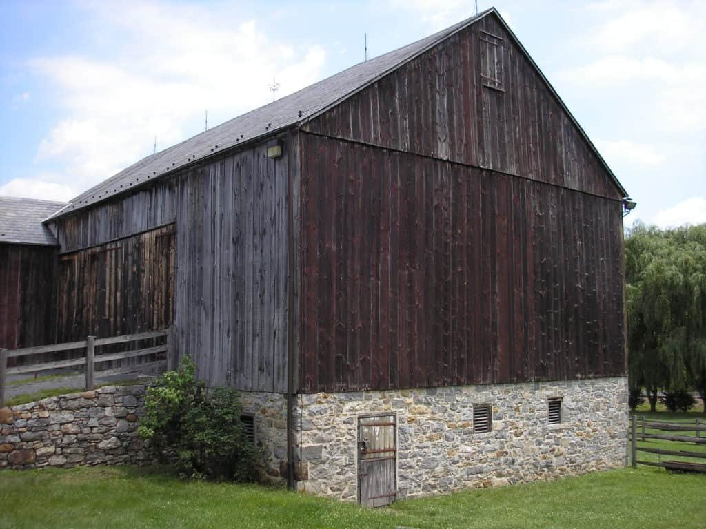 "The plantation's bank barn, so named for the ramp, or ""bank"" wagons would drive up to unload their cargo within the barn."