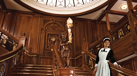 The grand staircase inside of the museum. This picture also shows the dress of one of the employees.