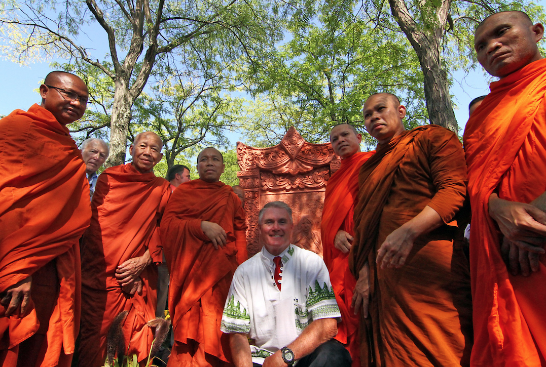 """Lowell City Councilor Rodney Elliott with Community of Khmer Buddhist Monks and monks from Glory Buddhist Temple after unveiling of Khmer Monument in front of Lowell City Hall.""