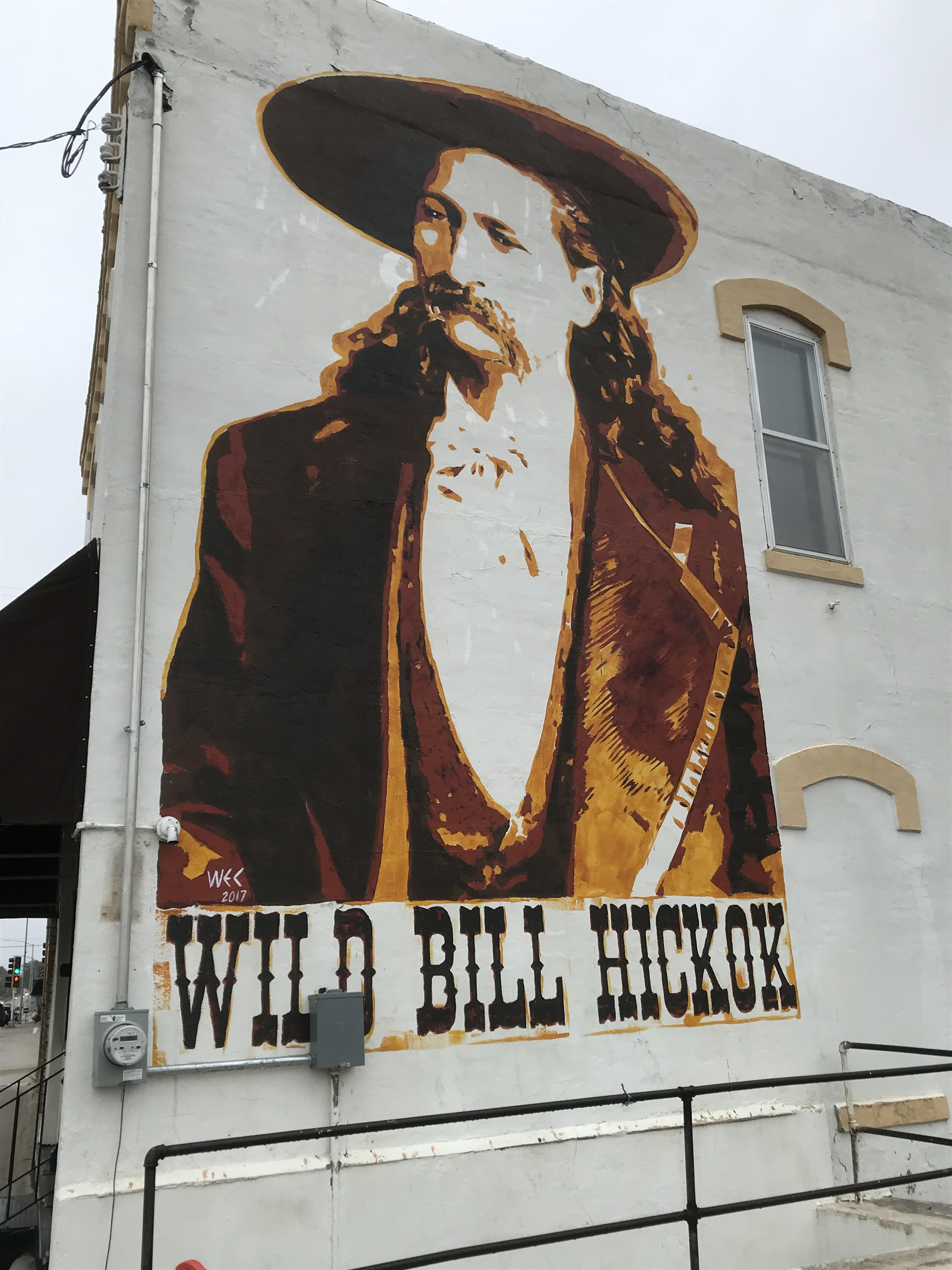 Mural of Hickok on the side of a building on Buckeye Ave. near Cottage Ave.
