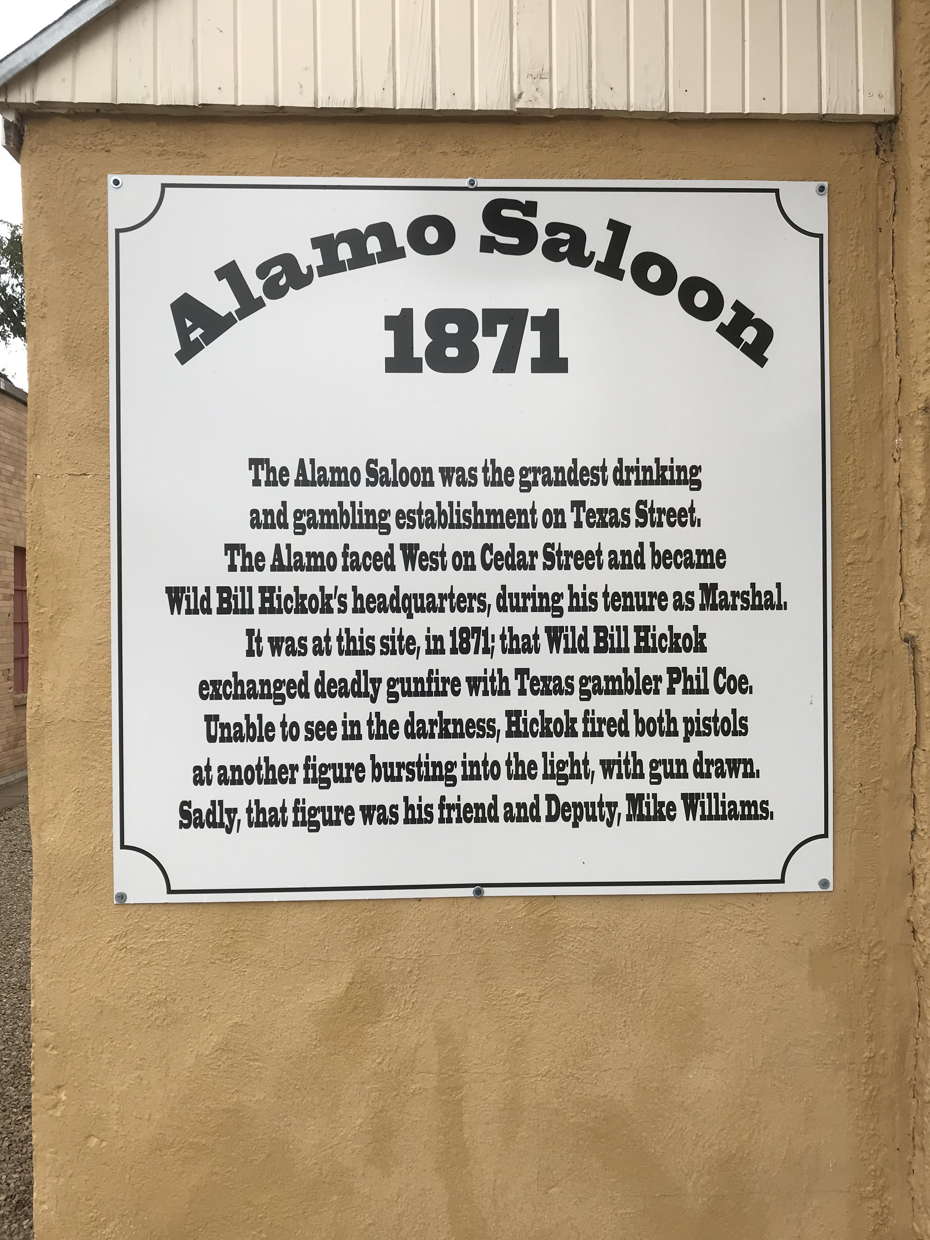 Commemorative sign at the original site of the Alamo Saloon on the corner of N Cedar St. and W 1st St.