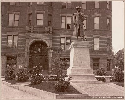 A photo from 1904 of the former Joseph Warren monument in Warren Square. Behind it is the Hotel Warren, which was also taken down along with the statue.