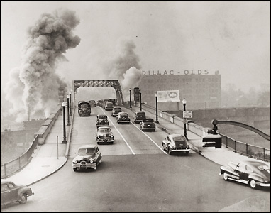A 1949 picture of the bridge with a steam locomotive and postwar automobile traffic