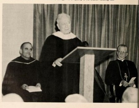 Fr. Michael McInerney receiving a honorary doctorate from St. Vincent's College following the construction of the Library, recognizing his architectural contributions to over 200 buildings and structures. Source: The Spire Yearbook, 1959.