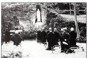 Monks of Belmont Abbey praying at the Our Lady of Lourdes Grotto. Source: Fr. Paschal Baumstein, OSB, Blessings in the Years to Come: Belmont Abbey, A Pictorial Perspective (Belmont, NC: Belmont Abbey Archives, 1999)