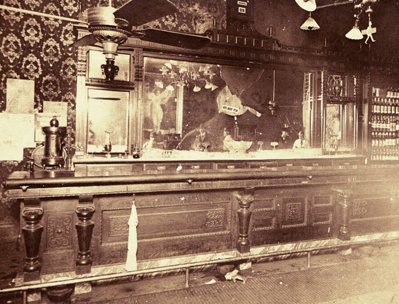 This is a picture of the bar of the Carey Hotel after Carry Nation was finished with her business. Local legend has it that passersby were milling around trying to grab a piece of broken glass as a souvenir.