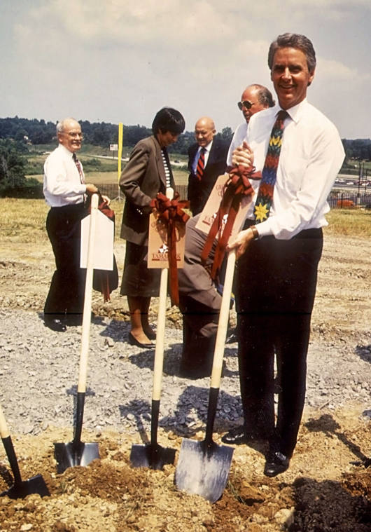 Governor Gaston Caperton, seen here at the 1994 groundbreaking ceremony, was instrumental in pushing for the creation of a facility to sell West Virginia-made products on a large scale. Image obtained from Tamarack.