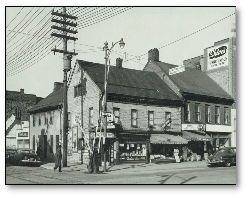 Photograph of the Golden Plough Tavern and the General Gates House before restoration work began in the early 1960s.