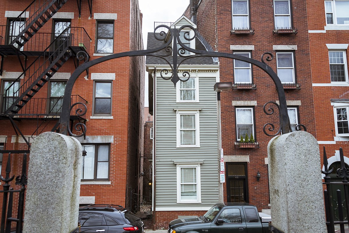 View of the Skinny House from the archway of Copp's Hill Burying Ground.