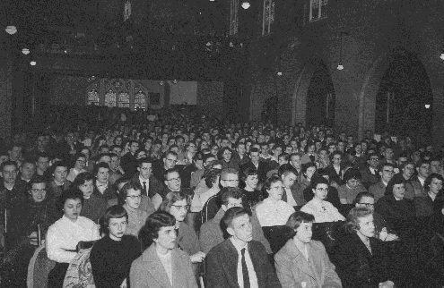 Students sitting in their assigned seats in Brown Chapel while attending a mandatory chapel every week.