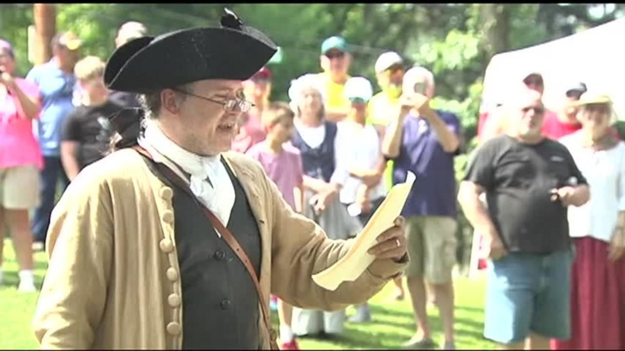 A period actor reads the Declaration of Independence on the front lawn of the George Taylor House.