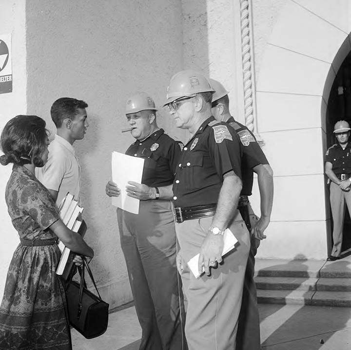 State troopers preventing Henry Hobdy and Dorothy Davis from entering Murphy High School in Mobile, Alabama.