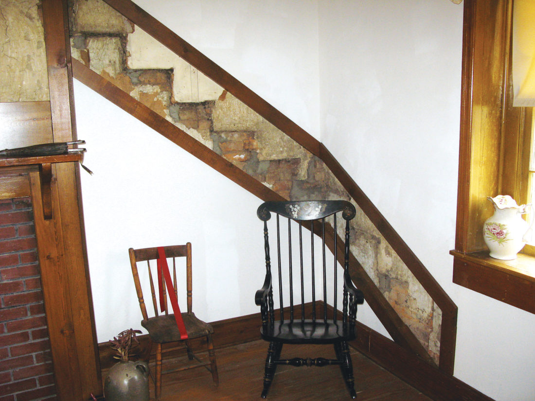 Original walls showing where a staircase was located was discovered when the paneling was removed in the Hugh's Room