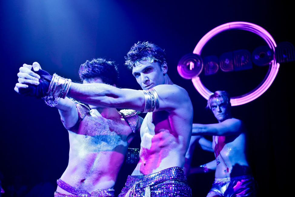 Photo taken in 2018 during performance of The Donkey Show at the Oberon. (By: Marcus Stern. Featuring: Eric Johnson, Tom Fish, and Mike Heslin. F. [https://americanrepertorytheater.org/explore/], from A.R.T.'s official website.)