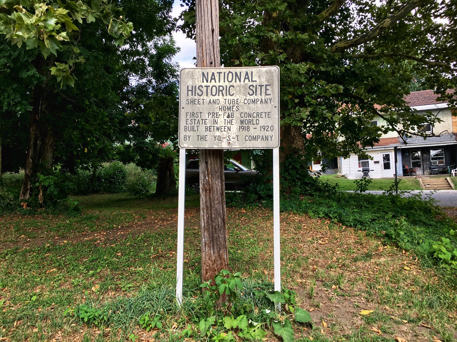 "The National Historic Site marker notes the Blackburn Plat was the ""first pre-fab concrete estate in the world."" The site was put on the Endangered list in 2011. (Source: Kaeleigh Herstad/Rustbelt Anthro)"