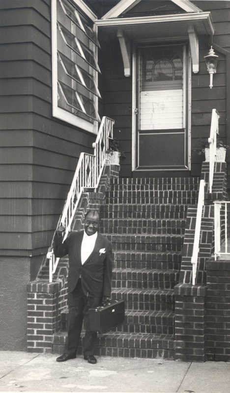 Armstrong in front of his home