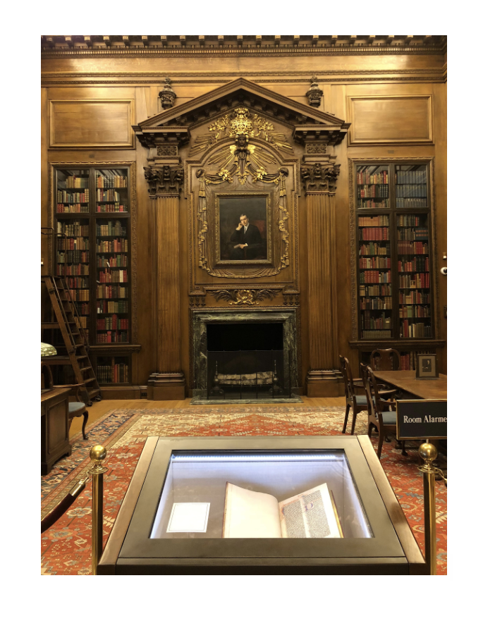 2018 view inside the Harry Elkins Widener Memorial Reading Room. Note the Gutenberg Bible in the foreground and the portrait of Harry Elkins Widener above the mantle.