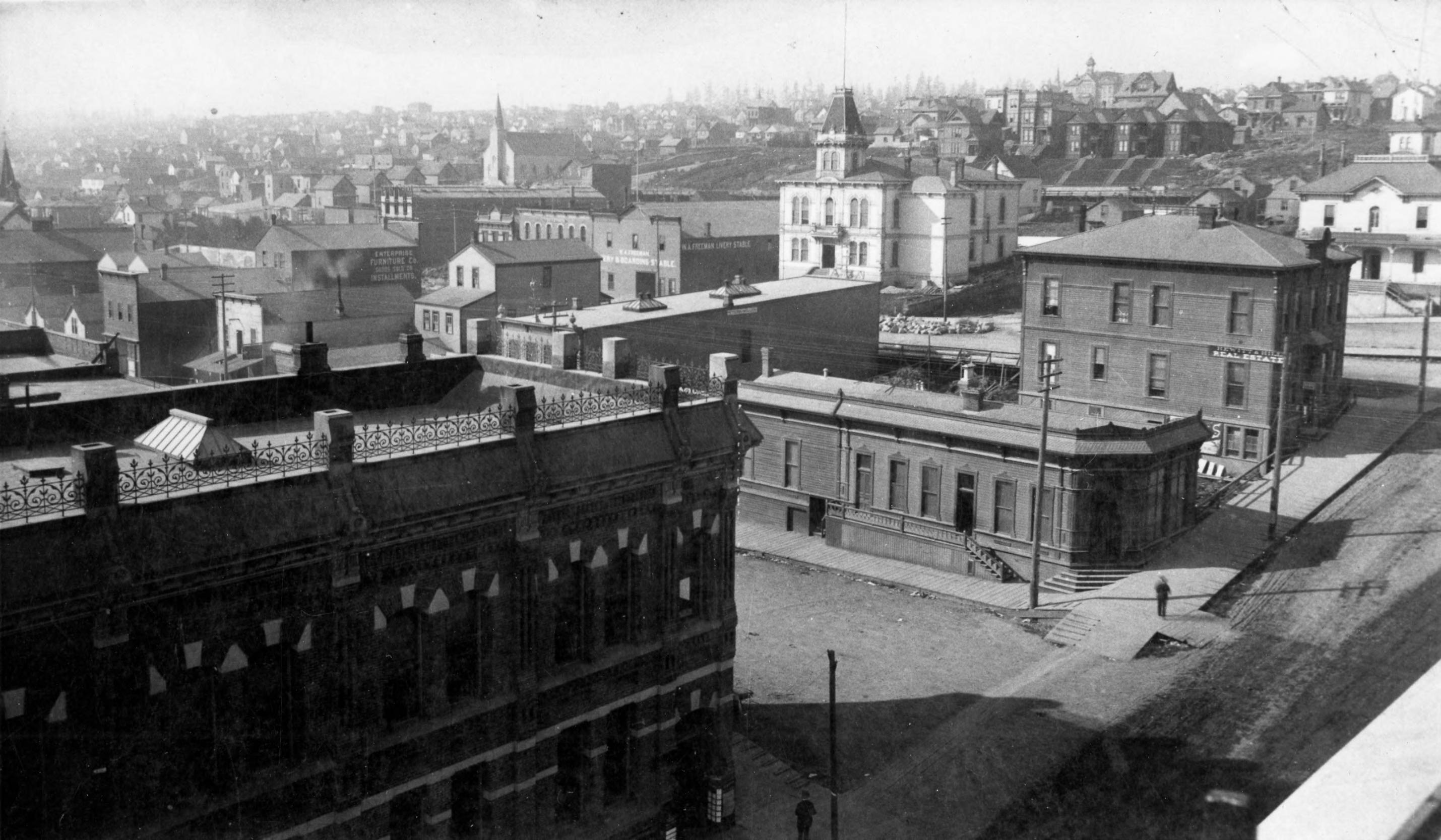 View of 9th & Broadway, circa 1885.  White building in upper part of image is Pierce County Courthouse.