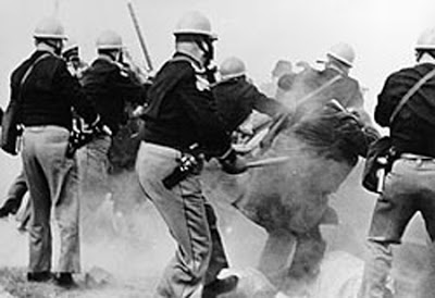 "This photo depicts the violence that occurred on Sunday March 7th, which is also referred to as ""Bloody Sunday."" Clara Luper participated in this protest"