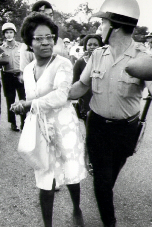 Clara Luper is pictured here being restrained by a police officer at one of the many demonstrations that she was a part of.