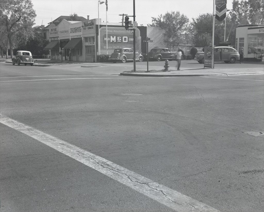 Intersection of E. Van Buren St. and N. Seventh St. in 1943 at the intersection where the Mercado would eventually be. In the photo you can see that there was a Chop Suey place, a Pie place, and a beauty shop.
