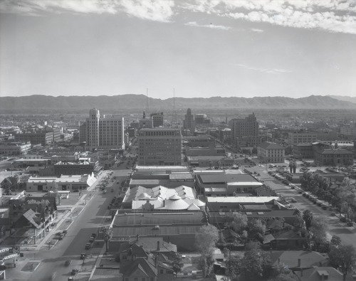 View of South Phoenix from Westward Hotel in 1930. The A.E. England Motor building at the time was in the area of the white tents to the right side. Image courtesy of ASU Library Digital Depository, McCulloch Bros. Inc. photographs (1884-1947).