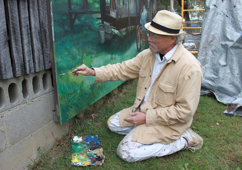 Artist Robert Dafford painting the Portsmouth Floodwall