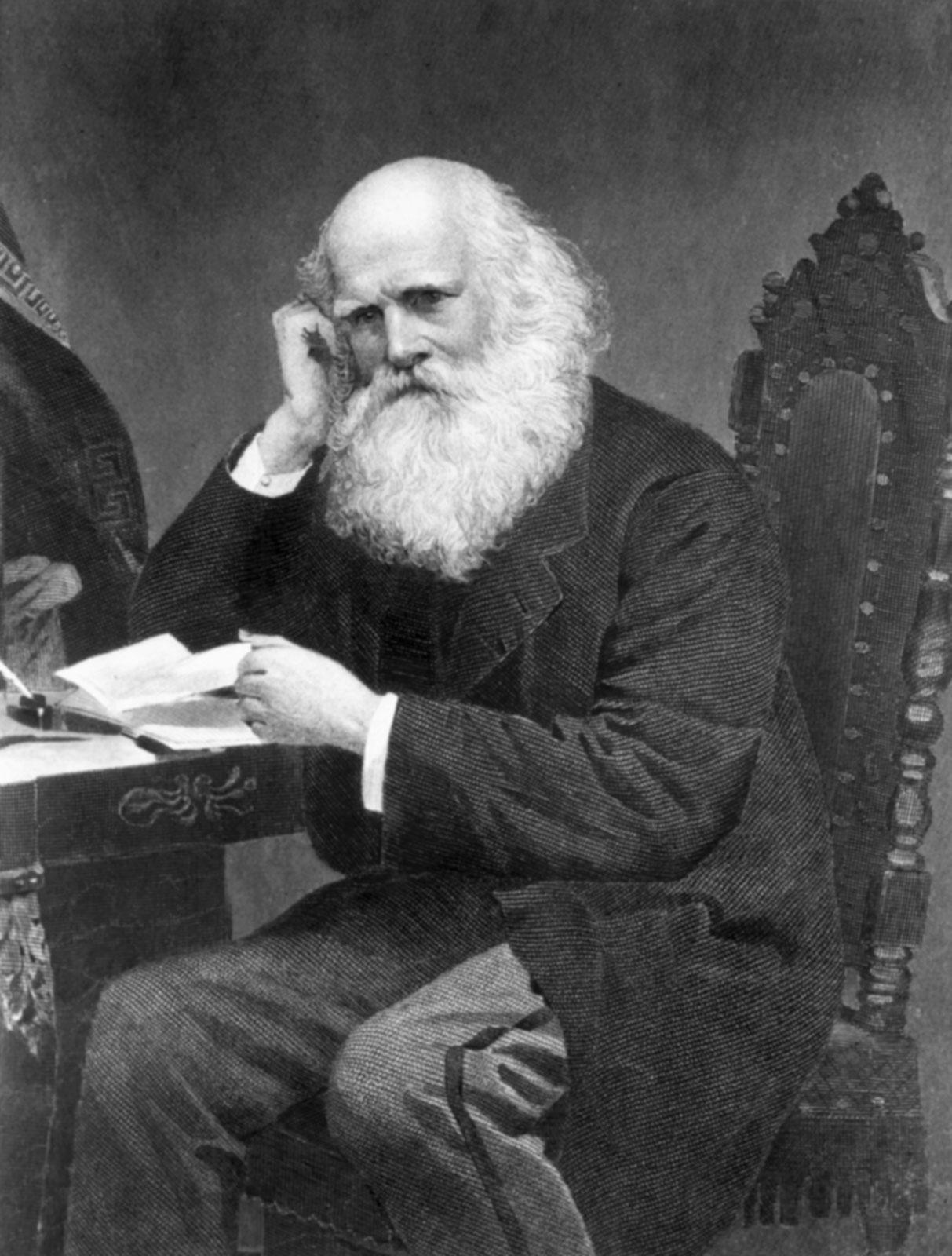 Facial hair, Hand, Sitting, Beard