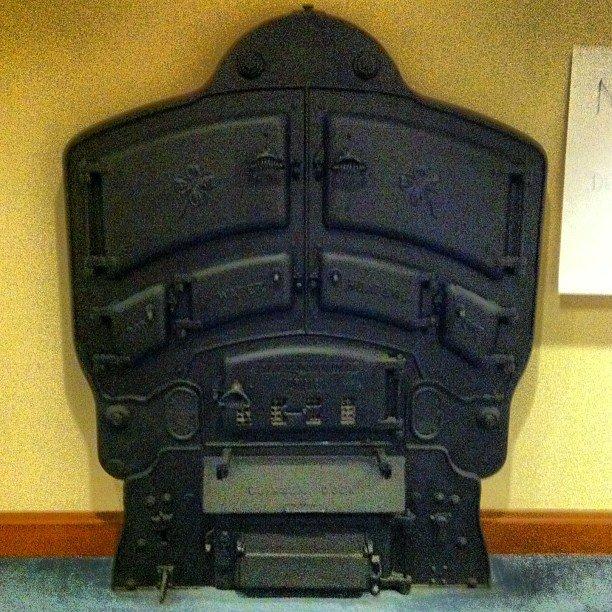 The beautiful, still-intact cast iron radiator. Built by the American Radiator Company.