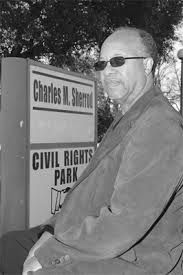 The Rev Charles Sherrod standing in front of the entrance of the Civil Rights park .