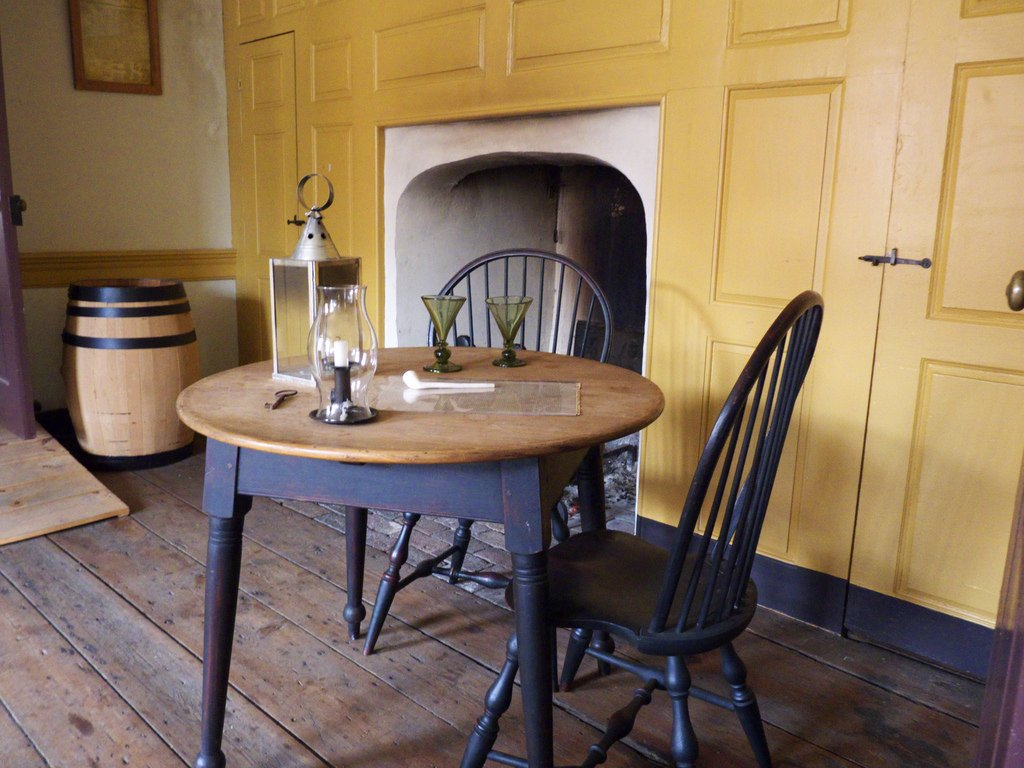 A small table placed in front of one of five fireplaces within the Bachmann House.