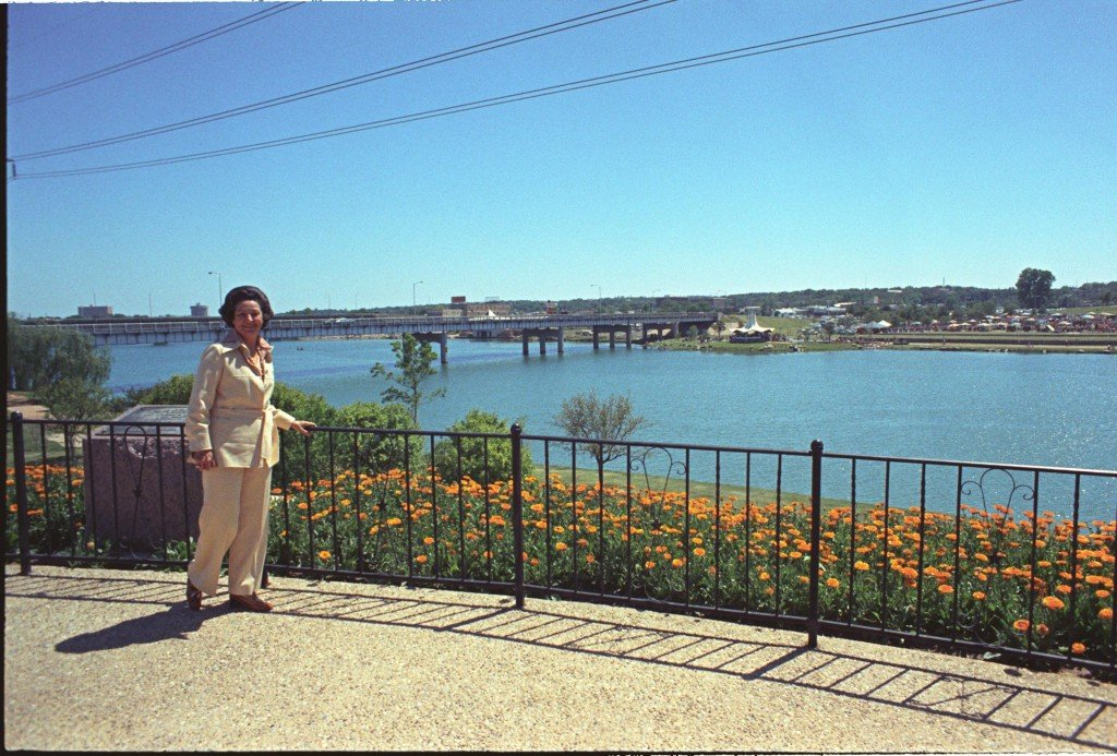 """Claudia """"Lady Bird"""" Johnson standing next to the """"Town Lake"""" (1974)  Lady Bird Johnson served as the Honorary Chairman of the Citizen's Committee, The lake named """"Town Lake"""" was renamed """"Lady Bird Lake"""" in her honor."""