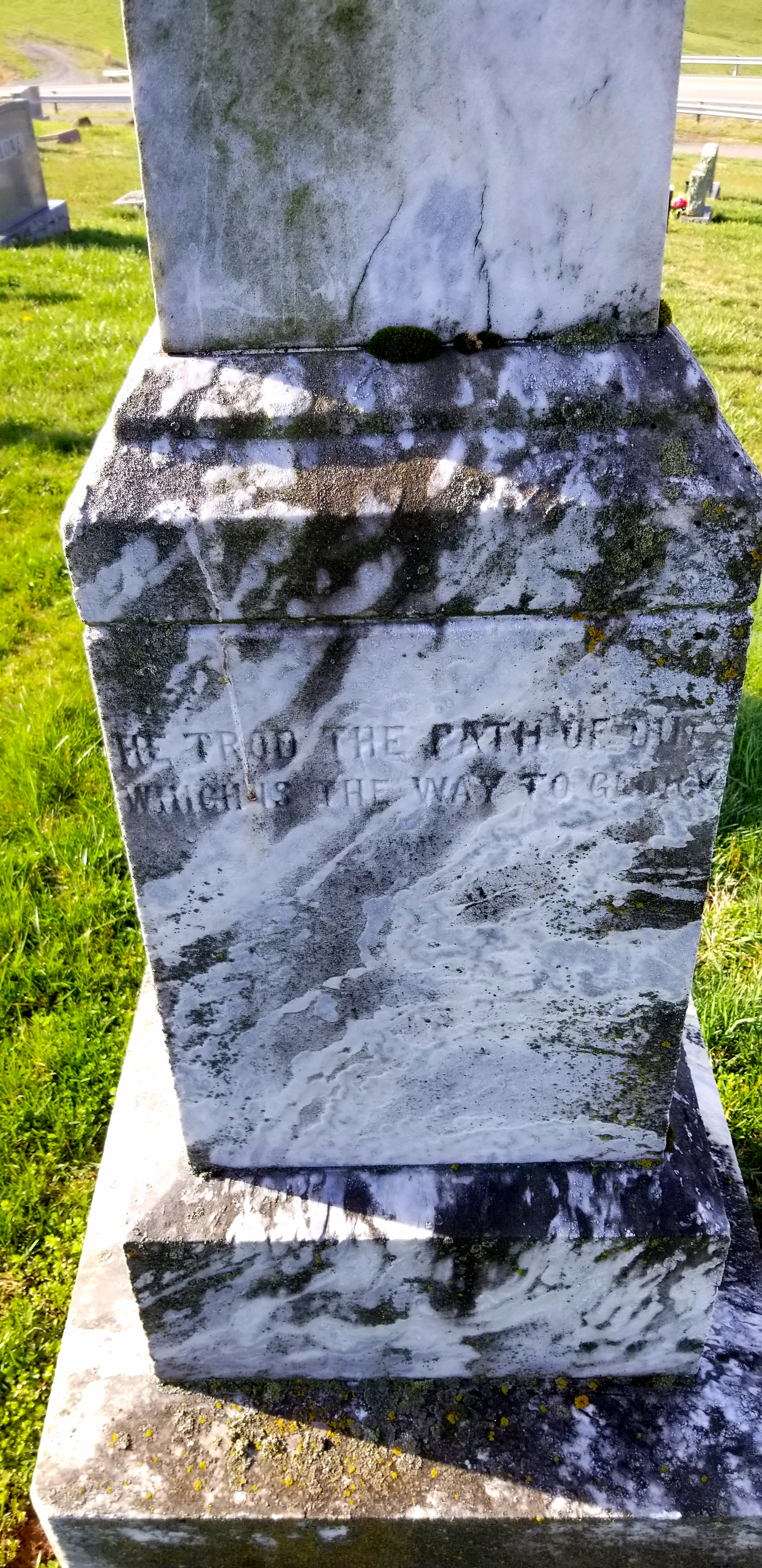"""close up on the right side of the memorial. It reads """"He trod the path of duty, which is the path to glory."""""""