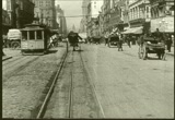 A screenshot of the film around present-day 7th and Market, near the present day BART station