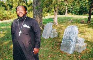 Rev. Moses Berry owns the cemetery and is the pastor at his church, which is not far from the cemetery.