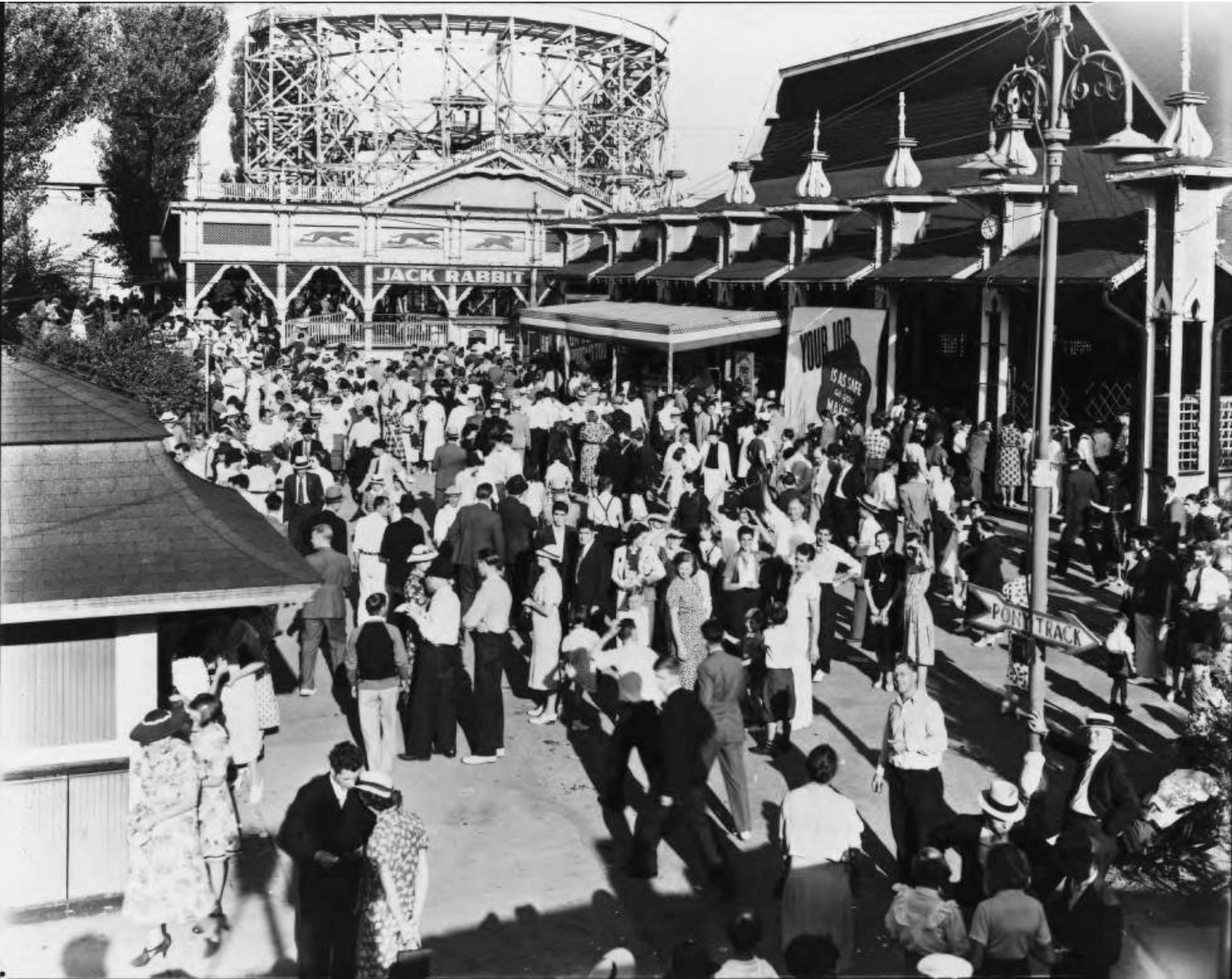 Youngstown Sheet and Tube Company employees at a picnic at Idora Park on Labor Day in 1939. The company sponsored an annual outing. The popular Jack Rabbit roller coaster is visible in the background.
