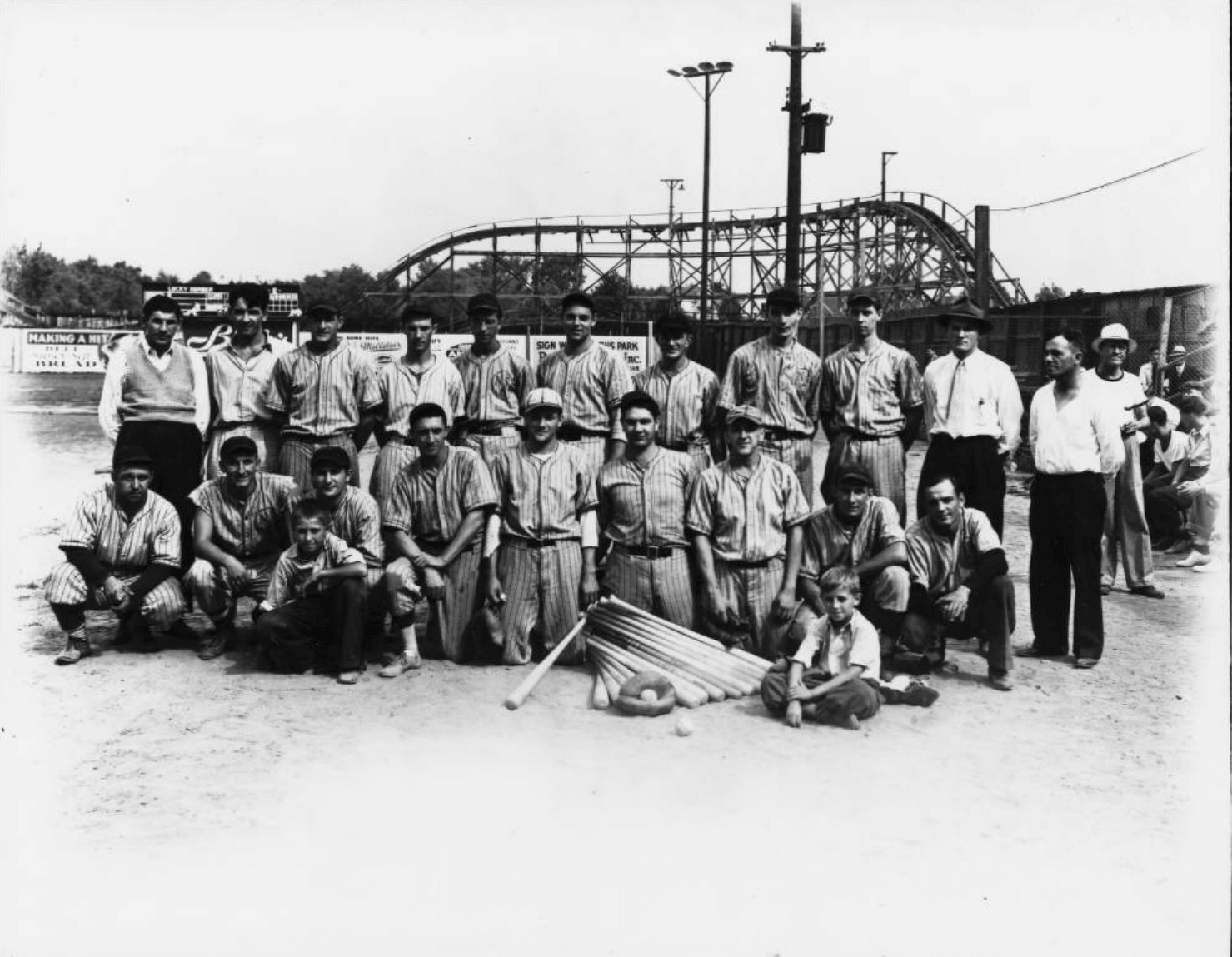 Youngstown Sheet and Tube Company employees before a baseball game at Idora Park on Labor Day in 1939. The Jack Rabbit roller coaster is visible in the background.