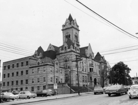 1972 photo, jail-sheriff's house front & left side of building; courthouse behind on right (Holmes)