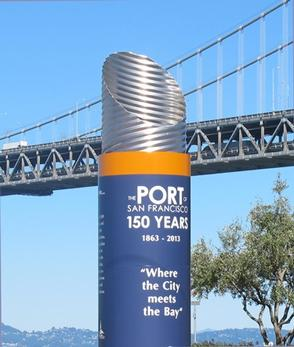 One of the cylindrical historical markers, which is part of the Port of San Francisco historical markers series along the waterfront near Fisherman's Wharf
