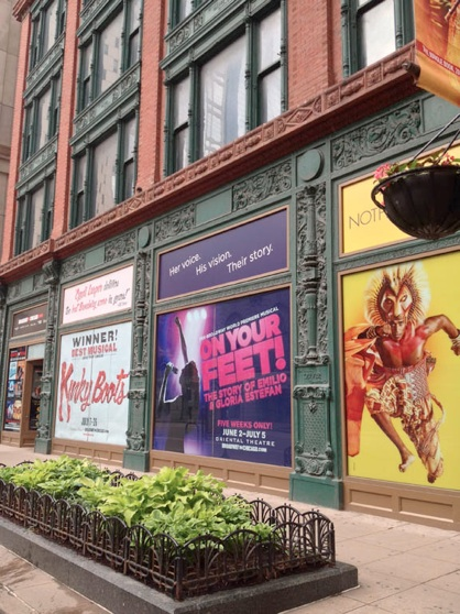 A mix of old and new. The Old Chicago-School framing and windows of the Oliver Building facade along with the theatre advertisements of the Theater that now occupies the vast majority of the building.