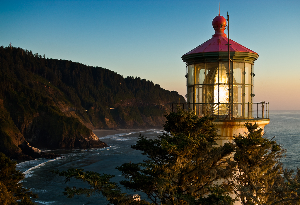Heceta Head lighthouse overlooks the Pacific Ocean as the sun sets.