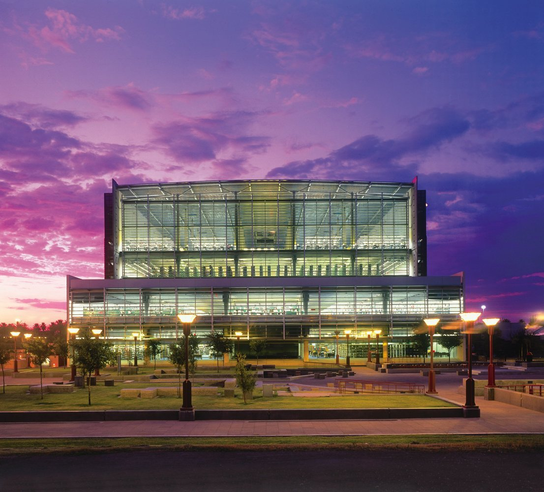 Beautiful front view of the Burton Barr Central Library at sunset.
