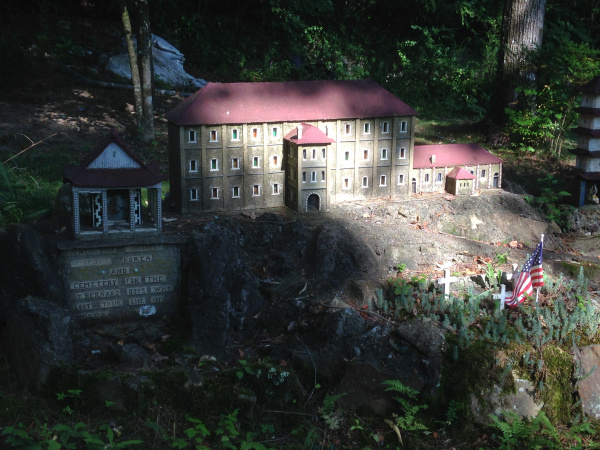 "Brother Joseph also built replicas memorializing St. Bernard's students — called ""St. Bernard Boys""  — who had been killed during war. The photo below shows a replica of a Benedictine monastery in Korea that was destroyed by Communists. The three crosses"