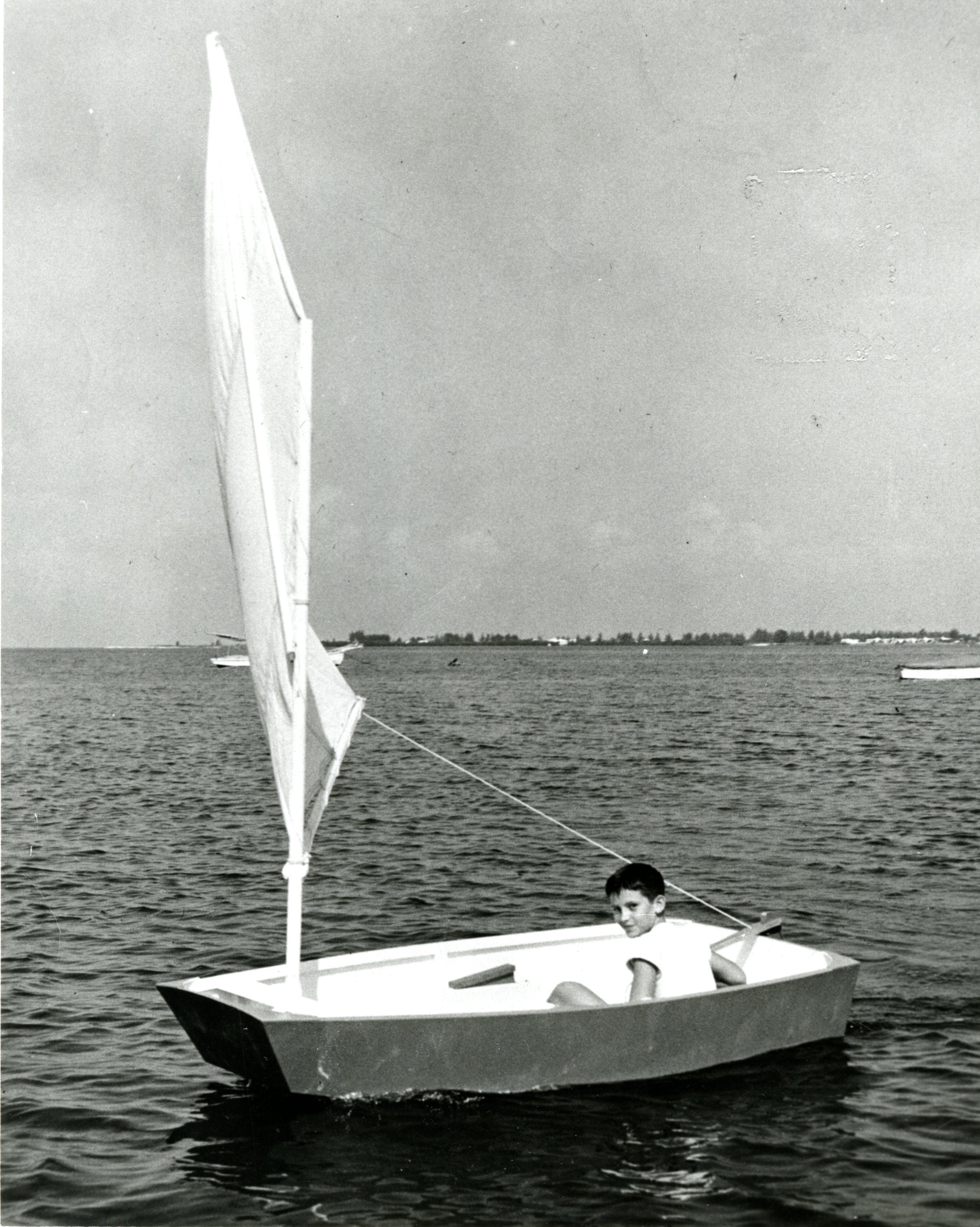 First Optimist Pram with skipper Clifford McKay Jr., Clearwater, Florida, circa 1948.