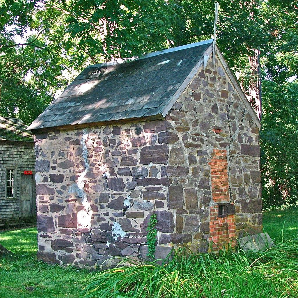 The stone smokehouse dates to c. 1850.