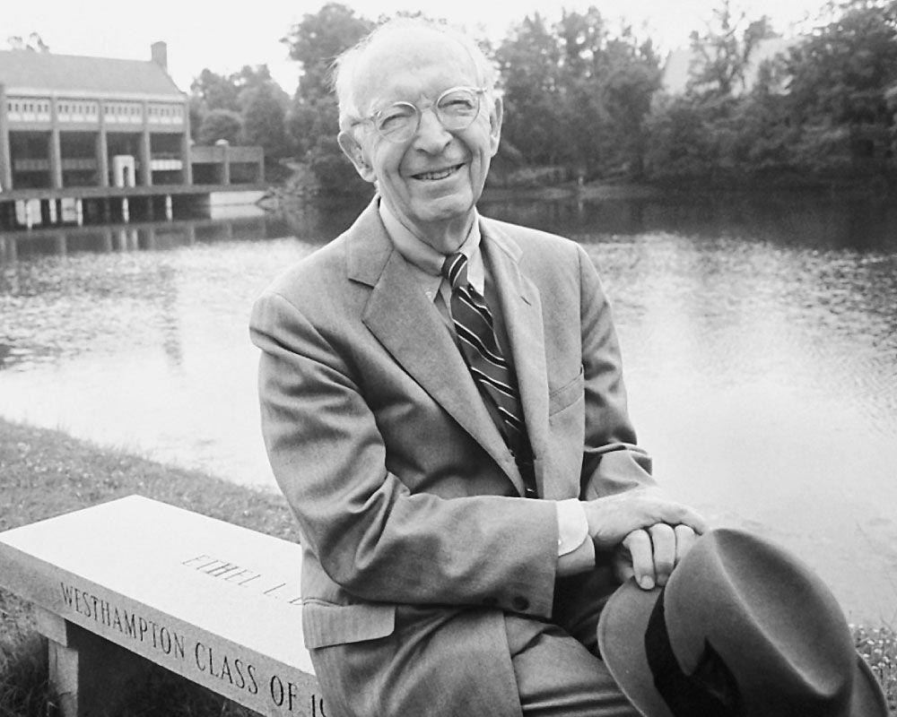 George Modlin posing next to Westhampton Lake. (Source: Pinterest, Professional & Continuing Studies - UR)
