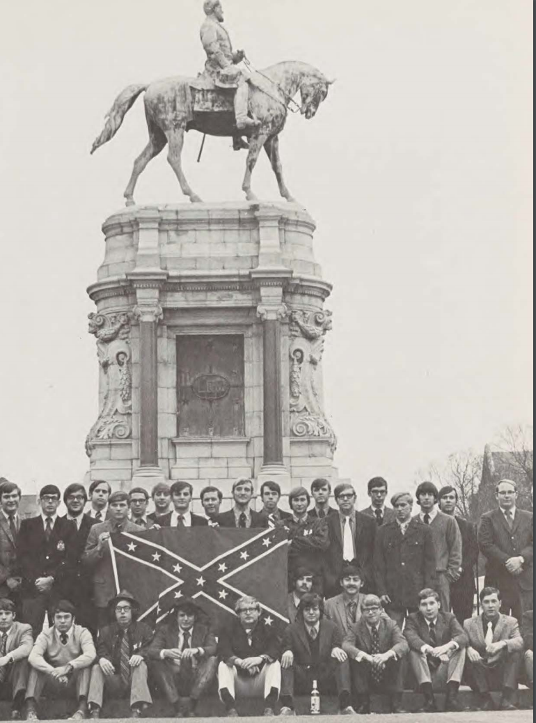 A 1971 yearbook photo of the Kappa Alpha fraternity holding a Confederate flag in front of the Robert E. Lee statue on Monument Avenue in Richmond, Virginia. (Source: Race & Racism Project)